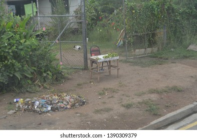 Port Moresby, Papua New Guinea - July 16, 2018: A small stand selling betel nut outside the gates of a dwelling. The betel nut costs 50 kina each. A pile of trash nearby is ready to be burned.