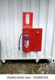 PORT MORESBY, PAPUA NEW GUINEA - CIRCA 2015: Fire extinguisher on the wall at a small oil service company in the capital