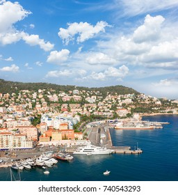 port of Nice and metiterranean sea at summer day under blue sky with cloud, France