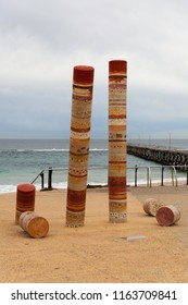 Port Noarlunga Beach with Jetty and Guildhouse art statue, ominent. Beach and Jetty in the Background.