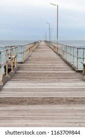 Port Noarlunga Jetty with cloud and sea.