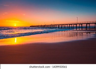 Port Noarlunga Jetty with fishermen at sunset viewed from beach side, South Australia