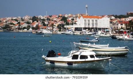 The port of Novalja is full of boats and the city center behind during the hot afternoon