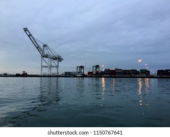 Port of Oakland, Oakland, CA, USA - January 28, 2016: Port of Oakland at dusk, taken from the water