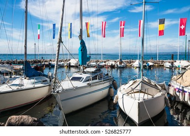 Port on Lake Garda. Flags of European countries. Summer landscape. Cisano, Italy. Europe.