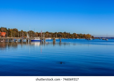 The port in Dießen on the West Bank of the Ammersee/ Ammersee in the morning