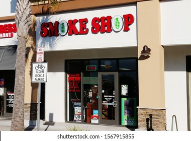 Port Orange, FL / USA -November 20, 2019:  Smoke Shop with Grenade  symbols or images in the sign  Selling  Vaping, cigar, cigarette and pipe smoking materials and paraphernalia