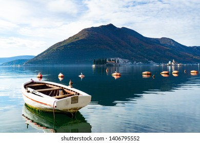 The port of Perast and the view at the island churches of St.Gregory and Our Lady of the rocks. Montenegro