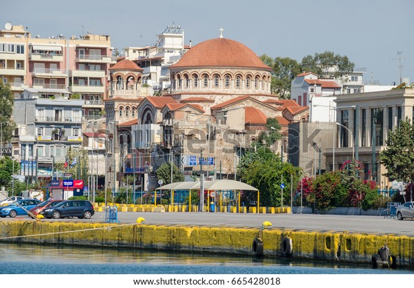 Port of Piraeus, Greece - Mai 30, 2017: The Holy Trinity Cathedral (In Greek Aghia Triada) - Jewel of Church Architecture - a byzantine rhythm church with a dome,  actually flying over the structure.