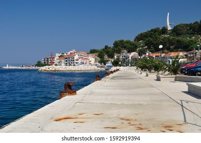 Port of Podgora in Croatia with sea in horizon and monument Seagull's wings. Podgora is a popular holiday resort.