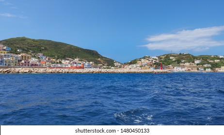 Port of Ponza, Pontine Islands, Italy, Lazio. Beautiful landscape. Colored houses on hillsides, azure Mediterranean sea and blue sky. View of the Tyrrhenian Sea. Travel around the island. Boat trip.