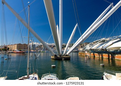 Port Porto Antico harbor with luxury white yachts and attractions, Bigo construction in historical centre of old european city Genoa Genova with blue sky in clear summer day, Liguria, Italy