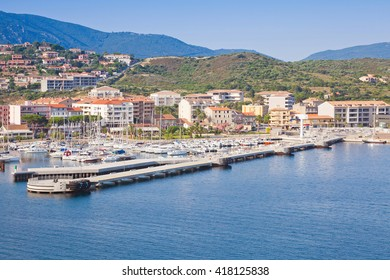 Port of Propriano, South region of Corsica island, France. Pier and coastal cityscape, sea view