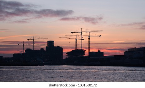 Port of Rotterdam at red colered day break, The Netherlands