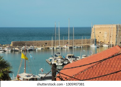 Port for sailing yachts, yachting, old fortress, red roofs of houses, morning at sea, view from the hotel window