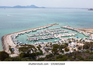 Port of Sidi Bou Said town with yachts and ships. Panorama of shore of the Mediterranean sea in Tunisia, Africa