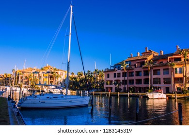 Port of Sotogrande. Port, sea, yachts and colorful houses. Sotogrande, Costa del Sol, Andalusia, Spain. Picture taken – 13 January 2019.