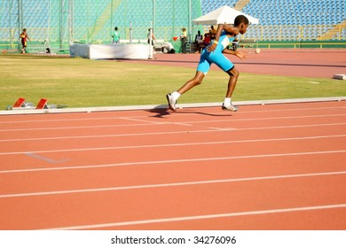 PORT OF SPAIN - JULY 26: Jevon Joseph sprints during the 35th Hampton International Games July 26, 2009 in Port of Spain, Trinidad & Tobago.