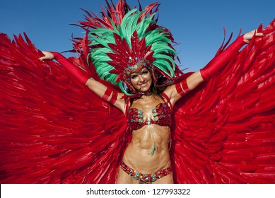 PORT OF SPAIN, TRINIDAD - FEB 12: A Female Masquerader enjoys herself in the Harts Carnival presentation 'Je Taime Carnival', February 12, 2013 in Port of Spain, Trinidad.