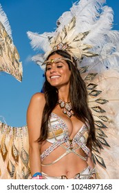 PORT OF SPAIN, TRINIDAD - February 13:  A female masquerader enjoys herself in the Harts Carnival presentation-Shimmer and Lace-, February 13, 2018 on the streets of Port of Spain, Trinidad.