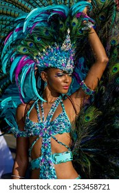 PORT OF SPAIN, TRINIDAD - February 17: A Female Masquerader enjoys herself in the Harts Carnival presentation-Dominion of the sun-, February 17, 2015 on the streets of Port of Spain, Trinidad.