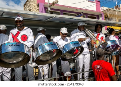 PORT OF SPAIN, TRINIDAD - February 17: Exodus steel orchestra band members perform in down town Port of Spain on carnival Tuesday, February 17, 2015 on the streets of Port of Spain, Trinidad.