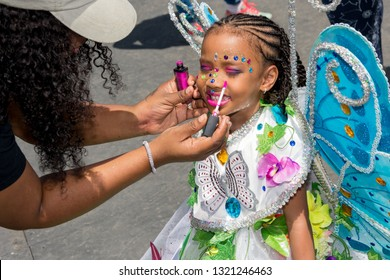 PORT OF SPAIN, TRINIDAD - February 23: Xynai Rameshwar 4 years is made up by her mother in The Trinidad Red Cross 2019 Children's Carnival, February 23, 2019 in Port of Spain, Trinidad.
