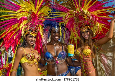 PORT OF SPAIN, TRINIDAD - March 4: Masqueraders enjoy themselves in the Harts Carnival presentation -Of Love and War-, March 4, 2014 on the streets of Port of Spain, Trinidad.