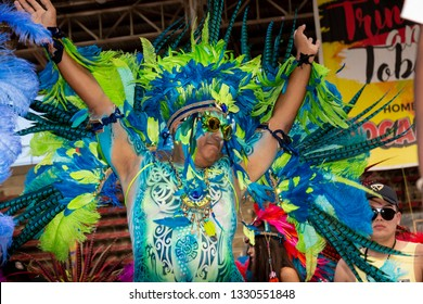PORT OF SPAIN, TRINIDAD – March 5:  A male Masquerader enjoys himself in the Harts Carnival presentation-Legendary-, March 5, 2019 in Port of Spain, Trinidad.