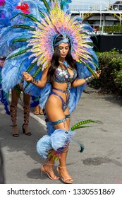 PORT OF SPAIN, TRINIDAD – March 5:  A female Masquerader enjoys herself in the Harts Carnival presentation-Legendary-, March 5, 2019 in Port of Spain, Trinidad.