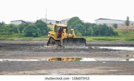Port of Spain / Trinidad Tobago - November 2015: Asphalt in La Brea Pitch Lake in Trinidad Tobago, Caribbean.