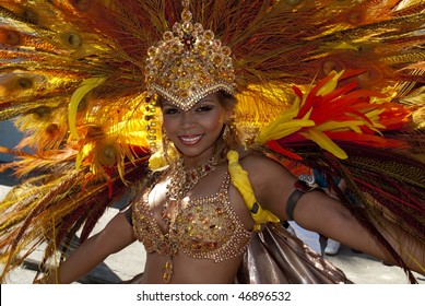 PORT OF SPAIN,TRINIDAD - FEBRUARY 16: A female Masquerader enjoys herself in the Harts Carnival presentation '50', February 16, 2010 in Port of Spain, Trinidad.