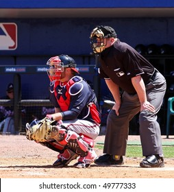 PORT ST. LUCIE, FLORIDA - MARCH 23: Atlanta Braves catcher Brian McCann sits behind home plate during the game against the New York Mets on March 23, 2010 in Port St. Lucie, Florida.