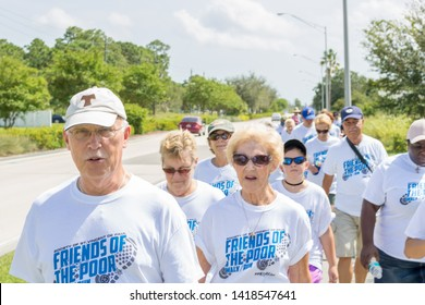 Port St. Lucie, Florida; USA; Sept. 30, 2017.  The local priest leads the community on this years charity walk. This Charity walk and run is held by the catholic church community of St Vincent de Paul