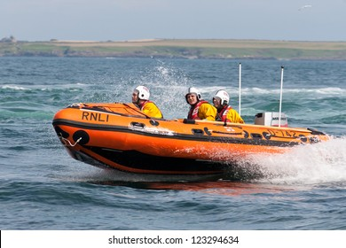 PORT ST. MARY, ISLE OF MAN, UK - AUGUST 22: Port St. Mary inshore lifeboat taking part in RNLI lifeboat festival on August 22, 2012 at Port St. Mary in the Isle of Man, UK.