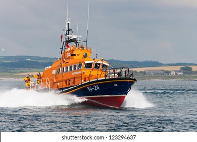 "PORT ST. MARY, ISLE OF MAN, UK - AUGUST 22: Port St. Mary lifeboat ""Gough Ritchie II"" (Trent class) taking part in RNLI lifeboat festival on August 22, 2012 at Port St. Mary in the Isle of Man, UK."