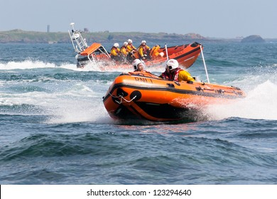 PORT ST. MARY, ISLE OF MAN, UK - AUGUST 22: Port St. Mary inshore lifeboat and Port Erin lifeboat taking part in RNLI lifeboat festival on August 22, 2012 at Port St. Mary in the Isle of Man, UK.