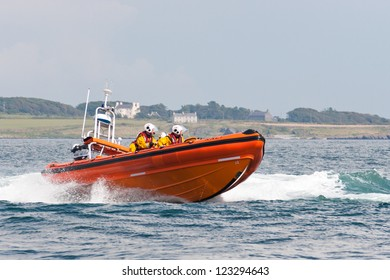 PORT ST. MARY, ISLE OF MAN, UK - AUGUST 22: Port Erin lifeboat (Atlantic 85 class) taking part in RNLI lifeboat festival on August 22, 2012 at Port St. Mary in the Isle of Man, UK.