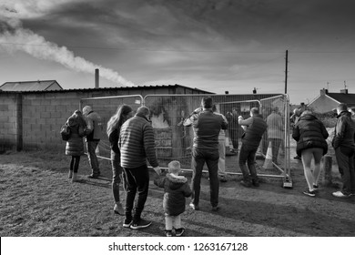 Port  Talbot in West wales  december 20th 2018 Peole gathering around the   Banksy painting in Port Talbot