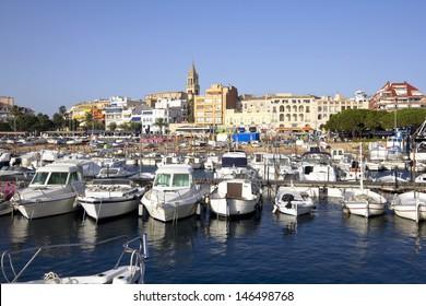 Port and touristic village of Palamos, Costa Brava (Catalonia, Spain) .Many fishing boats moored.