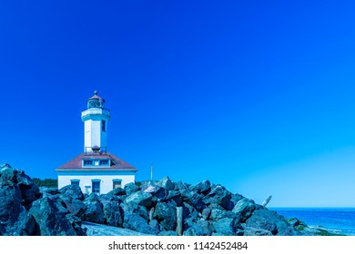 Port Townsend, Washington / USA - June 22, 2018: Wonderful view of The Point Wilson Lighthouse with blue sky 2,  Port Townsend, Washington.