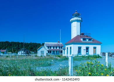 Port Townsend, Washington / USA - June 22, 2018: The Point Wilson Lighthouse panorama view, Port Townsend, Washington.