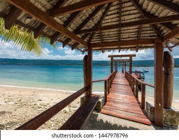 Port Vila, Vanuatu - April 6 2019: Jetty of a tropical Hideaway Island, Vanuatu, Port Vila, popular holidaymakers island for snorkeling. Close to Efate Island.