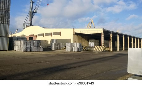 A port warehouse of aluminum ingots. Warehouse goods.