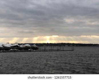Port Washington NY Manhasset Bay sunset with boats.