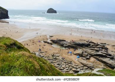 PORT WILLIAM,CORNWALL-JULY 27,2017: busy Trebarwith Strand beach near Tintagel Castle in North Cornwall, UK