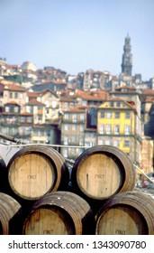 Port wine barrels on a boat on River Douro with Vila Nova de Gaia in the background, Porto, Portugal