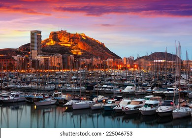 port with yachts against Castle of Santa Barbara in background during sunset. Alicante, Spain