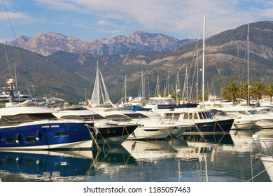 Port for yachts on the background of mountains. Montenegro, Bay of Kotor, Adriatic Sea, Tivat city. View of yacht marina of Porto Montenegro