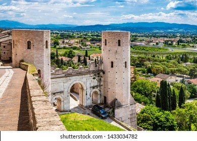 The Porta di Venere, from the Roman era, made of white travertine, with its three arches and the two towers of Properzio. In Spello, province of Perugia, Umbria, Italy.
